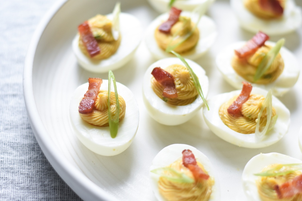 Bacon deviled eggs with creamy bacon fat yellow filling, low carb