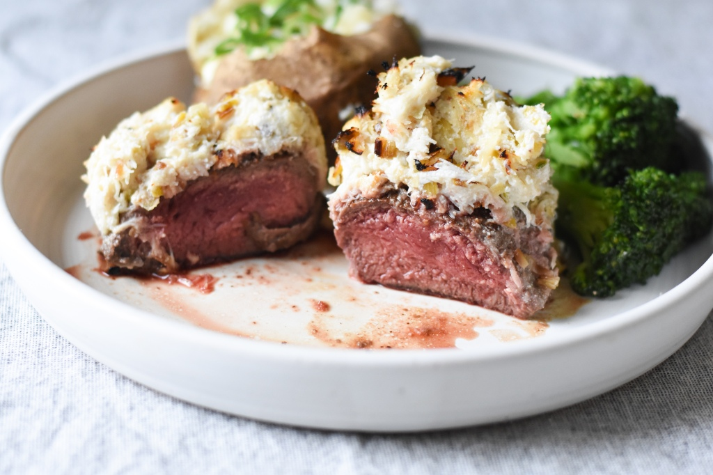 Medium rare steak topped with Dungeness Crab and leeks for Valentine's day